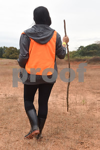 Natalie Sorge of Brownsboro uses a walking stick as she participates in a public search for missing child Kayla Gomez-Orozco held Saturday morning in Bullard. Hundreds of people gathered at Bullard High School at 7 a.m. to join in the effort to find the missing 10-year-old.  (Sarah A. Miller/Tyler Morning Telegraph)