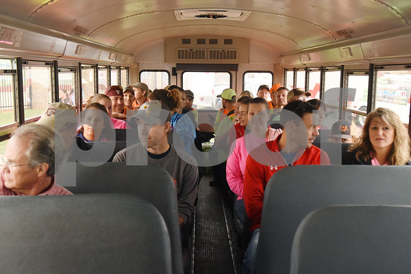 Volunteers ride a bus to a wooded area to look for missing child Kayla Gomez-Orozco Saturday morning in Bullard. Hundreds of people gathered at Bullard High School at 7 a.m. to join in the effort to find the missing 10-year-old.  (Sarah A. Miller/Tyler Morning Telegraph)