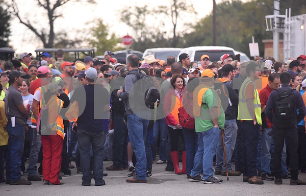 Volunteers wait in line to form search parties to look for missing child Kayla Gomez-Orozco Saturday morning in Bullard. Hundreds of people gathered at Bullard High School at 7 a.m. to join in the effort to find the missing 10-year-old.  (Sarah A. Miller/Tyler Morning Telegraph)