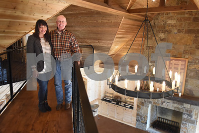 Venue director Emily McGraw and owner Donnie Lewis are pictured inside of the dairy barn that has been converted into a wedding venue Tuesday Jan. 10, 2017 at McNair Farm in Athens.  (Sarah A. Miller/Tyler Morning Telegraph)