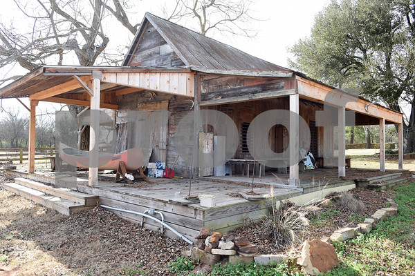 Donnie Lewis has the original 1873 Henderson County jail at his property, McNair Farm, in Athens.   (Sarah A. Miller/Tyler Morning Telegraph)