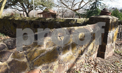 A 1930s fence surrounds Donnie Lewis' property, McNair Farm, in Athens. The property houses bees, an apothecary, a wedding venue and the 1873 Henderson County two cell jail.  (Sarah A. Miller/Tyler Morning Telegraph)