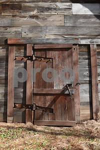 A door on the original 1873 Henderson County jail is pictured at Donnie Lewis' property, McNair Farm, in Athens.   (Sarah A. Miller/Tyler Morning Telegraph)