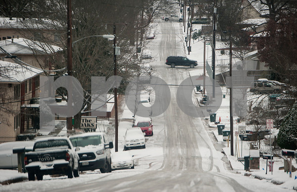 Cars parked along the road on Houston Street in Tyler, Texas are covered in snow on Tuesday Jan. 16, 2018. An overnight winter storm brought unusually cold temperatures, ice and snow to the East Texas region. Area schools were closes due to the inclement weather and road conditions.  (Sarah A. Miller/Tyler Morning Telegraph)