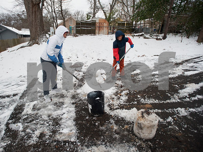 Siblings Destiny Young, 15, and Branden Young, 14, shovel snow to build a snowman in Tyler, Texas on Tuesday Jan. 16, 2018. An overnight winter storm brought unusually cold temperatures, ice and snow to the East Texas region. Area schools were closes due to the inclement weather and road conditions.  (Sarah A. Miller/Tyler Morning Telegraph)