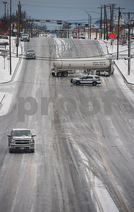 A truck is stuck sideways on Front Street just east of Beckham in Tyler, Texas on Tuesday Jan. 16, 2018. An overnight winter storm brought unusually cold temperatures, ice and snow to the East Texas region. Area schools were closes due to the inclement weather and road conditions.  (Sarah A. Miller/Tyler Morning Telegraph)