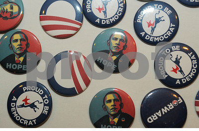 Obama campaign buttons for sale at the Smith Co. Democrats watch party Tuesday night. Herb Nygren Jr 110612