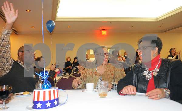 Dexter Jones, Eloyce Green and Bettye Mitchell cheer when President arak Obama takes the lead in the early Ohio returns at the Democrat watch party at the Holiday Inn on S. Boadway Tiuesday night. Herb Nygren Jr 110612