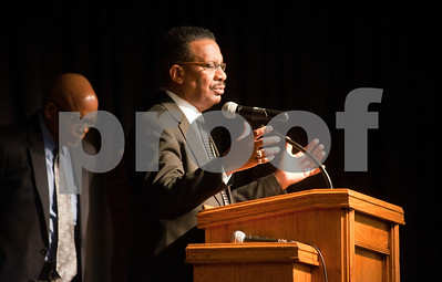 photo by Sarah A. Miller/Tyler Morning Telegraph  Texas College campus minister Rev. T.J. Davis, Jr. leads a prayer for students with dreams during the Dare to Dream program Friday in observation of Martin Luther King Junior Day at Texas College's Martin Hall Auditorium.