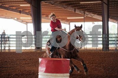 photo by Sarah A. Miller  Tammy Wolven of Flint competes in the Run for Hope Benefit Barrel Race, a fundraiser for her daughter, Saturday at Tyler Saddle Club Arena in Mt. Selman. Proceeds from the event went to help with medical expenses for two-year-old Tiffany Wolven of Flint. Tiffany was born with three rare genetic disorders. She has had five stomach surgeries and two brain surgeries and is only 23 months old.
