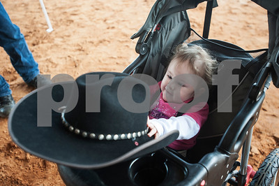 photo by Sarah A. Miller  Tiffany Wolven, 2, plays with her father Michael's cowboy hat at the Run for Hope Benefit Barrel Race Saturday at Tyler Saddle Club Arena in Mt. Selman. Proceeds from the event went to help with medical expenses for two-year-old Tiffany Wolven of Flint. Tiffany was born with three rare genetic disorders. She has had five stomach surgeries and two brain surgeries and is only 23 months old.