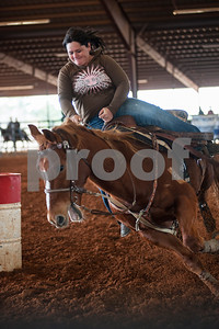 photo by Sarah A. Miller  Gillian Farquharson of Athen competes with her horse Bracken at the Run for Hope Benefit Barrel Race Saturday at Tyler Saddle Club Arena in Mt. Selman. Proceeds from the event went to help with medical expenses for two-year-old Tiffany Wolven of Flint. Tiffany was born with three rare genetic disorders. She has had five stomach surgeries and two brain surgeries and is only 23 months old.