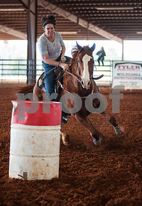 photo by Sarah A. Miller  Haley Jobe of Athens races her horse Poke at the Run for Hope Benefit Barrel Race Saturday at Tyler Saddle Club Arena in Mt. Selman. Proceeds from the event went to help with medical expenses for two-year-old Tiffany Wolven of Flint. Tiffany was born with three rare genetic disorders. She has had five stomach surgeries and two brain surgeries and is only 23 months old.