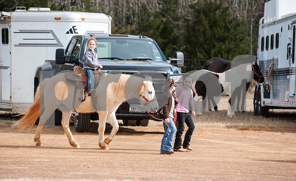 photo by Sarah A. Miller  Brilee Ford, 5, of Rusk is led by her sister Chesnea Ford, 7, center, and friend Mattie Baldwin, 7, of Rusk, right, at the Run for Hope Benefit Barrel Race Saturday at Tyler Saddle Club Arena in Mt. Selman. Proceeds from the event went to help with medical expenses for two-year-old Tiffany Wolven of Flint. Tiffany was born with three rare genetic disorders. She has had five stomach surgeries and two brain surgeries and is only 23 months old.