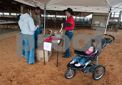 photo by Sarah A. Miller  Michael Wolven of Flint sells raffle tickets with his daughter Tiffany,  2,  nearby at the Run for Hope Benefit Barrel Race Saturday at Tyler Saddle Club Arena in Mt. Selman. Proceeds from the event went to help with medical expenses for two-year-old Tiffany Wolven of Flint. Tiffany was born with three rare genetic disorders. She has had five stomach surgeries and two brain surgeries and is only 23 months old.