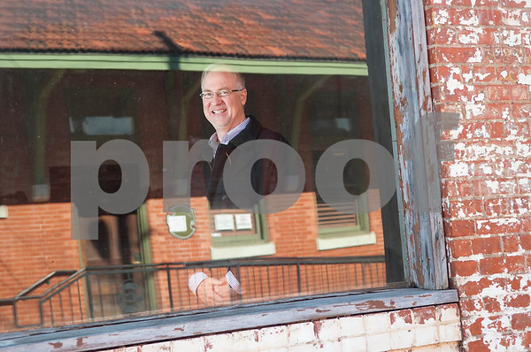 Tyler Mayor Martin Heines is pictured through the window of the building downtown that is being renovated for the Innovation Pipeline project.  (Sarah A. Miller/Tyler Morning Telegraph)