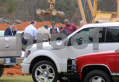 photo by Sarah A. Miller/Tyler Morning Telegraph  Smith County deputies and other officials extract one of three protestors who had chained themselves inside a section of pipe for the TransCanada Keystone Pipeline project near the intersection of County Road 363 and County Road 357, east of Winona, Texas Monday. The protesters were a part of the Tarsands Blockade, a group that aims to shutdown construction of the controversial pipeline.