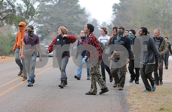 photo by Sarah A. Miller/Tyler Morning Telegraph  Tarsands Blockade protestors attempt to get closer to where officials worked to remove three protestors who had chained themselves inside a section of pipe for the TransCanada Keystone Pipeline project near the intersection of County Road 363 and County Road 357, east of Winona, Texas Monday. The three protesters were arrested for criminal trespass.