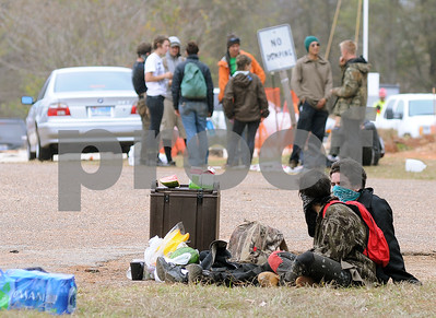 photo by Sarah A. Miller/Tyler Morning Telegraph  Tarsands Blockade protestors gather in support at the intersection of County Road 363 and County Road 357, east of Winona, Texas Monday where three of their fellow protestors had chained themselves inside a section of pipe  destined for the TransCanada Keystone XL Pipeline project.