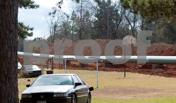 photo by Sarah A. Miller/Tyler Morning Telegraph The section of pipeline, pictured here, runs through a residential neighborhood near County Road 363 and County Road 357, east of Winona, Texas. Three members of Tarsands Blockade were arrested at this site Monday for criminal trespass after chaining themselves inside a section of pipe  destined for the TransCanada Keystone XL Pipeline project.