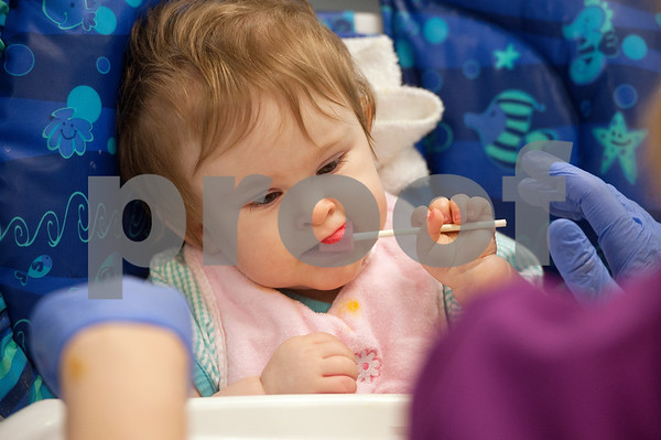 photo by Sarah A. Miller/Tyler Morning Telegraph  Tiffany Wolven, 2, puts a sucker in her mouth with help from a physical therapist at East Texas Children's Therapy Services Monday November 19 in Tyler. Tiffany eats through a feeding tube but is learning to eat with her mouth.