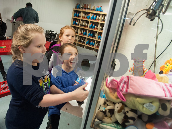 Madelyn Witt, 7, Gabriella White, 7, and Aubrey Elledge, 7, all of Henderson, try their luck with a claw machine filled with stuffed animals at Kilgore Skateland Thursday Jan. 22, 2016. The girls walked away empty handed.   (Sarah A. Miller/Tyler Morning Telegraph)