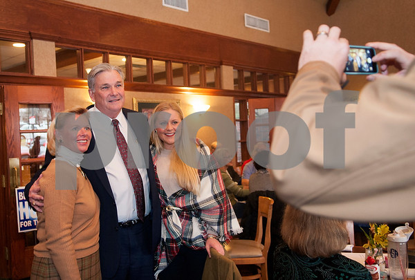 Sheriff Larry Smith takes a photo with Heather Stoner and Hunter Stoner before a forum with challenger Chris Green held by the Smith County Republican Women at Traditions Restaurant & Catering in Tyler Thursday Jan. 21, 2016.  (Sarah A. Miller/Tyler Morning Telegraph)