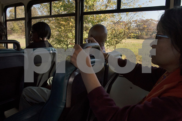 Passengers on the Tyler Transit bus take photos during the second annual Rosa Parks Day tour of historically significant areas of the city of Tyler on Friday Dec. 1, 2017. Tyler Transit Department and St. James CME Church hosted the free event which also included a program at the church and video presentation on African American history in the city of Tyler. Rosa Parks was known for refusing to give up her bus seat in the African American section of the bus to a white passenger when the whites-only section was full on Dec. 1, 1955 in Montgomery, Alabama.  (Sarah A. Miller/Tyler Morning Telegraph)