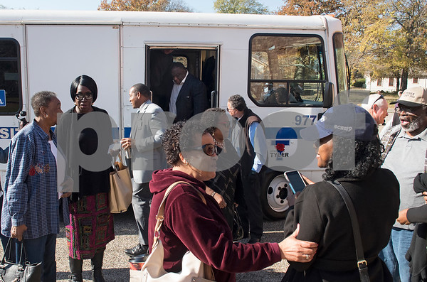 Passengers exit a Tyler Transit bus after attending the second annual Rosa Parks Day tour of historically significant areas of the city of Tyler on Friday Dec. 1, 2017. Tyler Transit Department and St. James CME Church hosted the free event which also included a program at the church and video presentation on African American history in the city of Tyler. Rosa Parks was known for refusing to give up her bus seat in the African American section of the bus to a white passenger when the whites-only section was full on Dec. 1, 1955 in Montgomery, Alabama.  (Sarah A. Miller/Tyler Morning Telegraph)