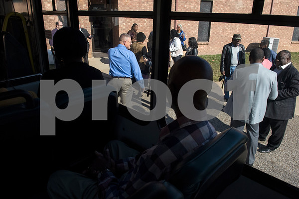 People wait to board a Tyler Transit bus for the second annual Rosa Parks Day tour of historically significant areas of the city of Tyler on Friday Dec. 1, 2017. Tyler Transit Department and St. James CME Church hosted the free event which also included a program at the church and video presentation on African American history in the city of Tyler. Rosa Parks was known for refusing to give up her bus seat in the African American section of the bus to a white passenger when the whites-only section was full on Dec. 1, 1955 in Montgomery, Alabama.  (Sarah A. Miller/Tyler Morning Telegraph)