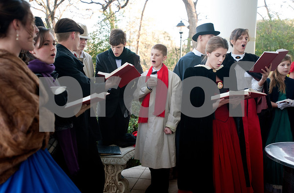"""photo by Sarah A. Miller/Tyler Morning Telegraph  Carolers sing traditional holiday songs on the front porch of the 1859 Goodman-LeGrand Museum during the Downtown Tyler Museum Alliance's annual Holiday Open House Thursday evening. The museum offered """"A Victorian Christmas"""" with vintage-type refreshments, entertainment and period re-enactors. Museums included in the event were the 1859 Goodman-LeGrand Museum, Cotton Belt Depot, Gallery Main Street, Smith County Historical Society and the McClendon House."""
