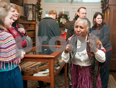 """photo by Sarah A. Miller/Tyler Morning Telegraph  Re-enactor Sheryl Chester plays Aunt Cely, a beloved servant who lived at the 1859 Goodman-LeGrand Museum during the Downtown Tyler Museum Alliance's annual Holiday Open House Thursday evening. The museum offered """"A Victorian Christmas"""" with vintage-type refreshments, entertainment and period re-enactors. Museums included in the event were the 1859 Goodman-LeGrand Museum, Cotton Belt Depot, Gallery Main Street, Smith County Historical Society and the McClendon House."""