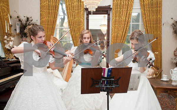 """photo by Sarah A. Miller/Tyler Morning Telegraph  Audrey Dukes, 18, Bethany Baber, 14, and Laura Nicholson, 18, play violin in the Gold Room of the 1859 Goodman-LeGrand Museum during the Downtown Tyler Museum Alliance's annual Holiday Open House Thursday evening. The museum offered """"A Victorian Christmas"""" with vintage-type refreshments, entertainment and period re-enactors. Museums included in the event were the 1859 Goodman-LeGrand Museum, Cotton Belt Depot, Gallery Main Street, Smith County Historical Society and the McClendon House."""
