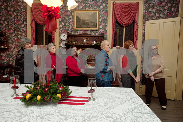 photo by Sarah A. Miller/Tyler Morning Telegraph  A group of women take a tour of the McClendon House during the Downtown Tyler Museum Alliance's annual Holiday Open House Thursday evening. Museums included in the event were the 1859 Goodman-LeGrand Museum, Cotton Belt Depot, Gallery Main Street, Smith County Historical Society and the McClendon House.