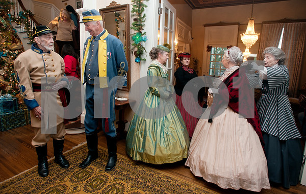 """photo by Sarah A. Miller/Tyler Morning Telegraph  Volunteers wear period attire at the 1859 Goodman-LeGrand Museum during the Downtown Tyler Museum Alliance's annual Holiday Open House Thursday evening. The museum offered """"A Victorian Christmas"""" with vintage-type refreshments, entertainment and period re-enactors. Museums included in the event were the 1859 Goodman-LeGrand Museum, Cotton Belt Depot, Gallery Main Street, Smith County Historical Society and the McClendon House."""