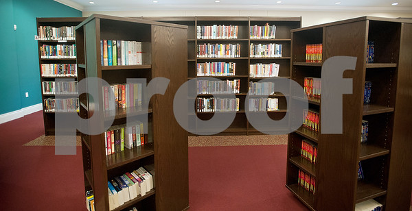 Books line the shelves inside of Overton's McMillian Memorial Library, part of the Rusk County Library System.  (Sarah A. Miller/Tyler Morning Telegraph)