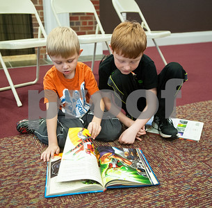 Brothers, Carston Davis, 5, of Overton, and  Conner Davis, 8, read a book at the McMillian Memorial Library in Overton Wednesday. The library is part of the Rusk County Library System.  (Sarah A. Miller/Tyler Morning Telegraph)