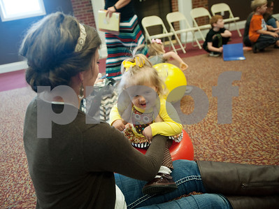 Ashley Posey of Overton bounces her daughter Laykynn Posey, 1, during Baby & Me Fun Time at the McMillian Memorial Library in Overton Wednesday. The library is part of the Rusk County Library System.  (Sarah A. Miller/Tyler Morning Telegraph)