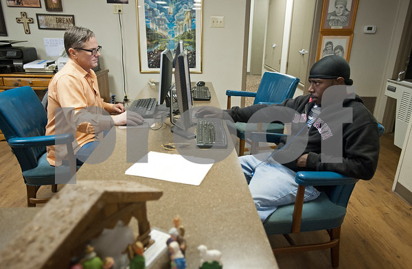 photo by Sarah A. Miller/Tyler Morning Telegraph  Cary Boatner, left, and Avery Dykes, right, use computers at Gateway to Hope Tuesday Dec. 16, 2014 in Tyler, Texas. Gateway to Hope is a resource day center for homeless people and those in need living in the Tyler and Smith County. Boatner used the computer to search for job opportunities and Dykes used the computer to work on a play about homelessness he wrote. Through a network of partners, Gateway to Hope provides resources such as clean showers, computer access, laundry facilities, transportation, food and clothing to the homeless and those in need.