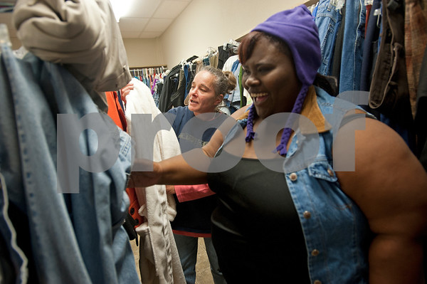 photo by Sarah A. Miller/Tyler Morning Telegraph  Bobbie Smith, left, and Tia Thompson, right, look through clothes available to them for free at Gateway to Hope Tuesday Dec. 16, 2014. Gateway to Hope is a resource day center for homeless people living in the Tyler and Smith County. Through a network of partners, Gateway to Hope provides resources such as clean showers, computer access, laundry facilities, transportation, food and clothing to the homeless and those in need.