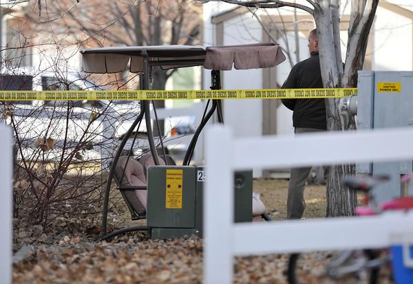 Weld County Sheriffs deputies investigate the scene, Tuesday, Dec. 18, 2012, in Longmont.<br /> (Matthew Jonas/Times-Call)