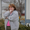 Nearby resident Leslie McGill watches as Weld County Sheriffs deputies and Longmont Police investigate the scene, Tuesday, Dec. 18, 2012, in Longmont.<br /> (Matthew Jonas/Times-Call)