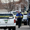 Weld County Sheriffs deputies investigate the scene, Tuesday, Dec. 18, 2012, in Longmont.<br /> (Matthew Jonas/Times-Call)