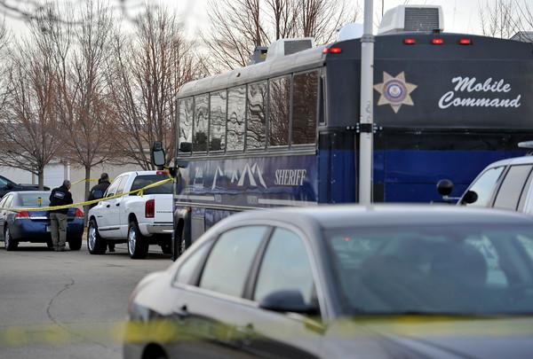 Weld County Sheriffs deputies and Longmont Police investigate the scene, Tuesday, Dec. 18, 2012, in Longmont.<br /> (Matthew Jonas/Times-Call)
