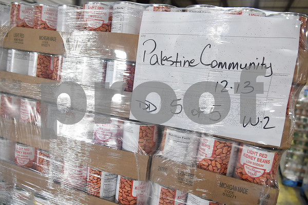 A pallet of food is marked for the Palestine Community Food Pantry at the East Texas Food Bank Monday Dec. 12, 2016 in Tyler. The East Texas Food Bank serves 26 counties by providing food to nearly 200 partner agencies to distribute to those in need.   (Sarah A. Miller/Tyler Morning Telegraph)