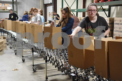 Students from the Tyler Area Christian Home Educators group package boxes for the Senior Box Program at the East Texas Food Bank Monday Dec. 12, 2016 in Tyler.  The Senior Box Program provides a free box of nutritious food to more than 2,000 seniors each month.  (Sarah A. Miller/Tyler Morning Telegraph)