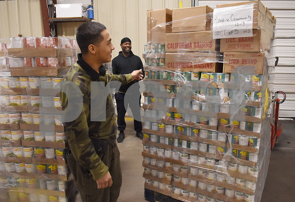 Junior Molina and Damon Smith work inside the East Texas Food Bank Monday Dec. 12, 2016 in Tyler. The East Texas Food Bank serves 26 counties by providing food to nearly 200 partner agencies to distribute to those in need.   (Sarah A. Miller/Tyler Morning Telegraph)