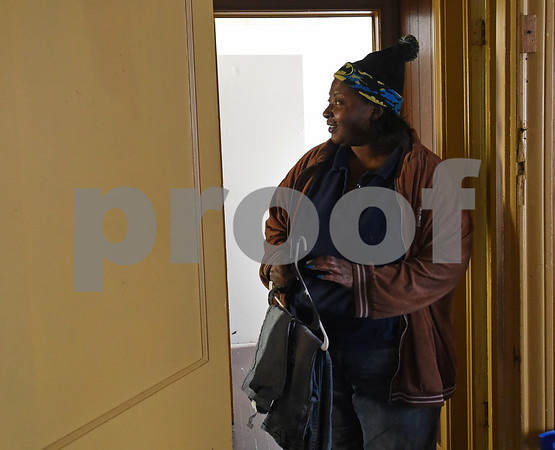Chevon Andrews puts away clothes at her new home Monday Dec. 19, 2016 in Tyler. The family had previously been staying at the Salvation Army homeless shelter.   (Sarah A. Miller/Tyler Morning Telegraph)