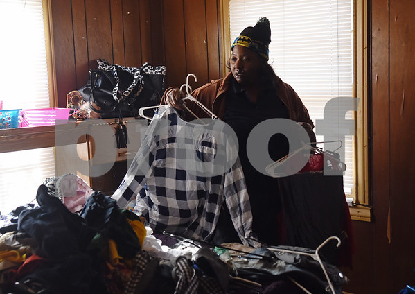 Chevon Andrews puts unpacks clothes at her new home Monday Dec. 19, 2016 in Tyler. The family had previously been staying at the Salvation Army homeless shelter.   (Sarah A. Miller/Tyler Morning Telegraph)