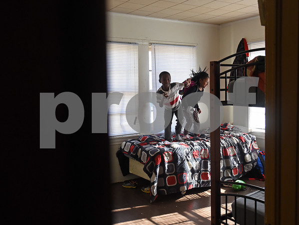 Siblings Ja'Micah Edwards, 6, and Destiny Edwards, 4, play in their bedroom at their new home Monday Dec. 19, 2016 in Tyler. The family had previously been staying at the Salvation Army homeless shelter.   (Sarah A. Miller/Tyler Morning Telegraph)
